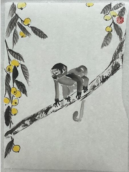 Affe mit gelben Früchten