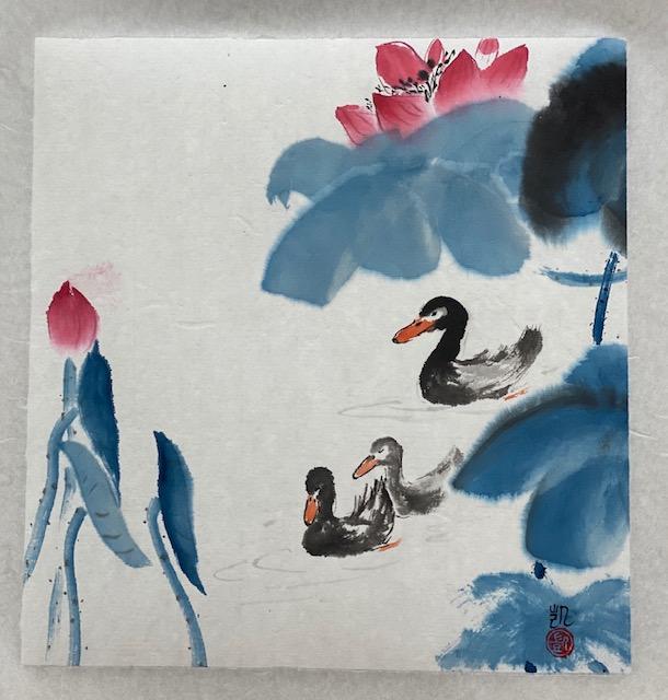 Entenfamilie mit blauem Lotus