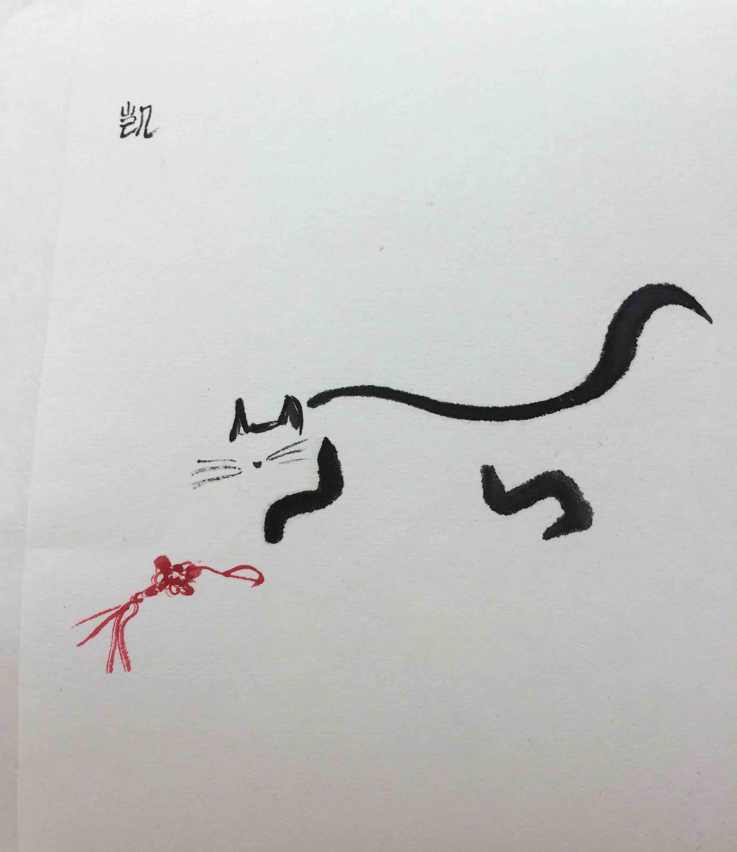 Katze spielt mit chinesischem Glücksknoten